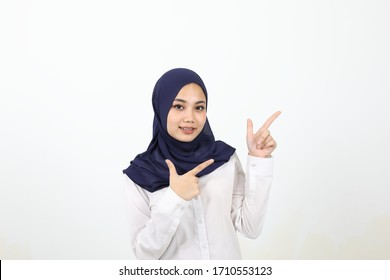 South east Asian Malay Woman headscarf facial expression show point finger up