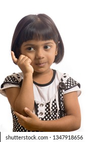 South East Asian six year old baby girl with thinking pose