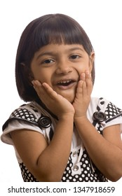 South East Asian six year old baby girl with surprise expressions