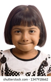 South East Asian six year old baby girl closeup isolated on white background