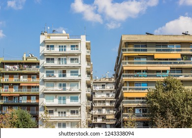 south European Mediterranean city street urban view with apartment buildings symmetry facade in summer warm clear bright weather time