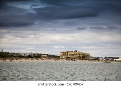 SOUTH FREMANTLE, AUSTRALIA, APRIL 26: An abandoned power station stands over a popular beach south of Fremantle in 2014. The station was closed in 1985 and its four chimney stacks were demolished.