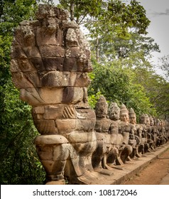 South gate to angkor thom in Cambodia is lined with warriors and demons
