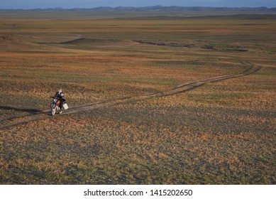 South Gobi, Mongolia, November 19 2018; A Mongolian cashmere herder returns to her ger after collecting water from a natural spring in the South Gobi desert
