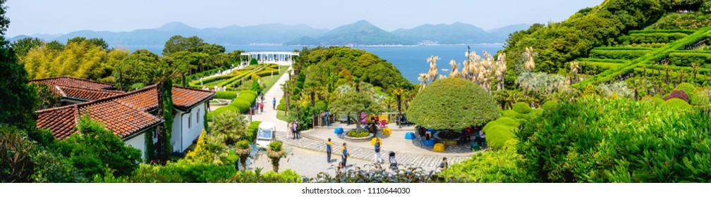 SOUTH GYEONGSANG, SOUTH KOREA - APRIL 28, 2018 : Botanical garden on Oedo Botania island in the southern region of Geoje islands with many tourist.