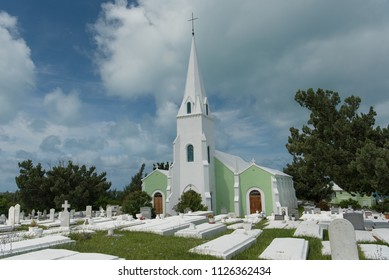 South Hampton, Bermuda - June 27, 2018: A small parish church surrounded by a cemetery on the island of Bermuda.