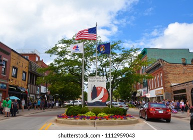 SOUTH HAVEN, MI / USA - AUGUST 12, 2017: Visitors stroll in downtown South Haven during the Blueberry festival.