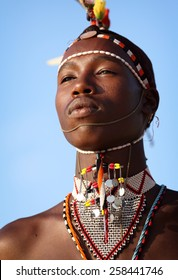 SOUTH HORR - KENYA - JANUARY 20, 2015: Unidentified Samburu warrior with traditional headdress and necklace on January 20, 2015 in South Horr, Kenya.