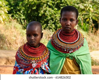 SOUTH HORR, KENYA - JULY 08: Young African girls from the Samburu tribe with characteristic decorative necklaces on the market in Kenya, South Horr in July 08, 2013