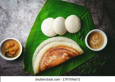 South Indian breakfast Idli Dosa sambar and chutney served in banana leaf