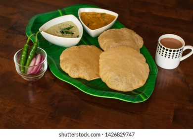 South Indian breakfast Puri with chutney and gravy, Poori and sagu with tea, Indian breakfast puri with tea on wooden table