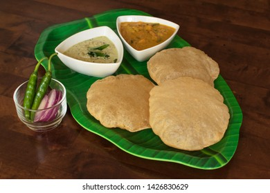 South Indian breakfast Puri with chutney and gravy, Indian breakfast puri with gravy and chutney on wooden table