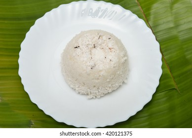 South Indian breakfast puttu made of rice flour and coconut, Kerala, India. White puttu with  lentil curry or banana is delicious Kerala Cuisine.
