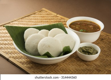 South Indian breakfast recipe Idly or Idli / rice cake served with coconut chutney and sambar, selective focus