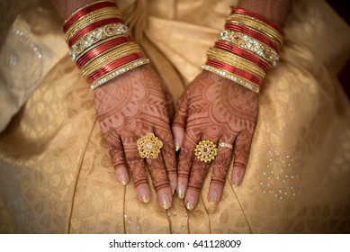 South Indian bride's hands with rings on a wedding day