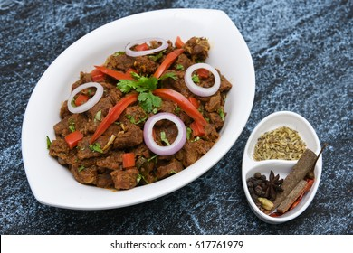 South Indian dish spicy beef fry / meat curry Kerala, India. side dish ghee rice, appam, parotta, puttu, bread and chappathi, Kerala cuisine , Indian food for Ramadan, Ramzan, Eid Christmas, Easter