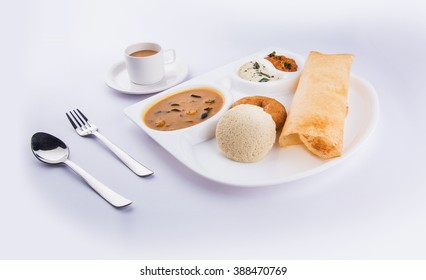 south indian food dosa, idli or idly, vada, sambar coconut chutney and hot tea