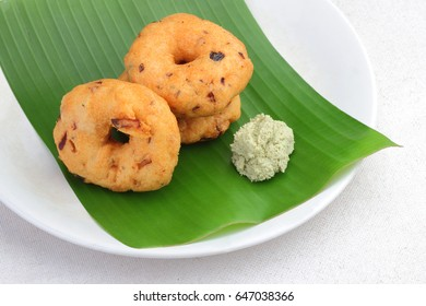 South Indian food 'Vadai' with coconut chutney on banana leaf