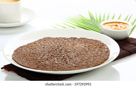 South Indian meal  ragi dosa with chutney.