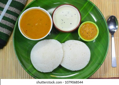 South indian popular breakfast Idli served with chutney and sambar.