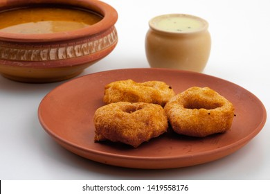 South Indian Popular Breakfast Vada Served With Sambar And Coconut Chutney Also Know as Vadai, Vade or Medu Vada