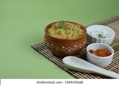 South Indian rice bath with cord on table mat, indian spicy pulav, spicy rice bath