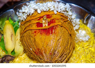South Indian thaali wrapped around coconut and decorated with garland as per tradition.