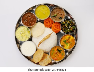 south Indian Thali served in marriages,vegetarian indian thali lunch,meals with rice, phulka(chapatti), puri(poori), curries, sambar, rasam, pulao, papad and sweets  Complete nutritional indian food
