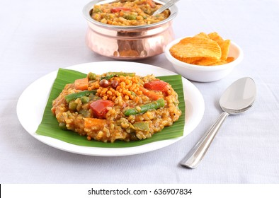 South Indian traditional and popular vegetarian rice dish, bisi bele bath, which has rice and pigeon pea as the main ingredients.