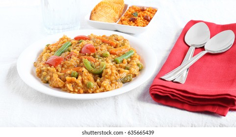 South Indian traditional vegetarian rice dish, bisi bele bath, with rice and pigeon pea as the main ingredients.