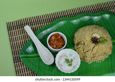 south Indian vegetable pulav and curd with ingredients, Indian rice bath in traditional bowl, pulao on green background