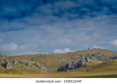 South Island, New Zealand, Feb 12th, 2019: The Castle hill. Southern Alps. Arthurs Pass. Castle rocks. panorama curve pathway at Castle Hill alps mountain