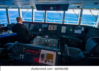 SOUTH ISLAND, NEW ZEALAND- MAY 25, 2017: Ferry boat pilot command cabin with the captain operating the machines with a beautiful view on the sea, in new zealand