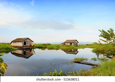 South Kalimantan, Indonesia - Maret 5, 2009: A woman does her house work at Nagara City. It is common that villagers in this city have a house on the river.