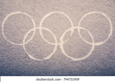 South Korea -February 9, 2018: White Winter Olympic Games symbol rings on the fleece background