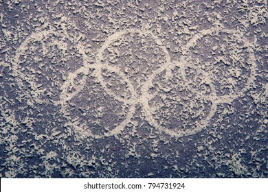 South Korea -February 9, 2018: Snowy Winter Olympic symbol rings on the background