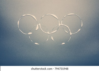 South Korea -February 9, 2018: Winter Olympic Games symbol rings on the metalic silver background