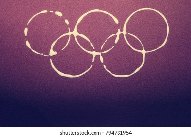 South Korea -February 9, 2018: Winter Olympic games symbol rings on the colorful violet background