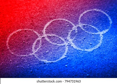 South Korea -February 9, 2018: South Korean flag colours Winter Olympic symbol rings on the background