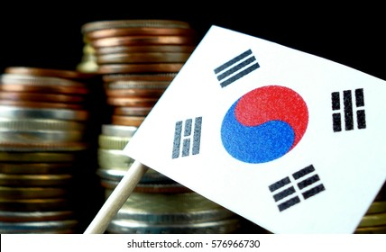 South Korea flag waving with stack of money coins macro