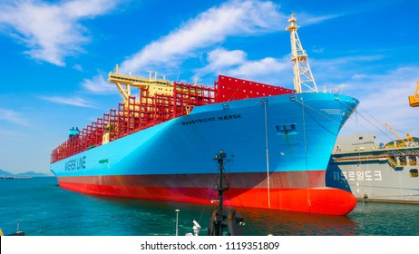 South Korea - June 2018 : Daewoo Shipyard (DSME) in Okpo city, The bay consists of commercial ship, tug boat, shipyard facilities and off shore platforms.