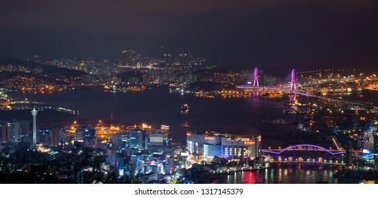 South Korea landscapes. at Busan City and Downtown skyline in Busan, South Korea.South Korea cityscapes.Busan harbor bridge at night. Busan Port, South Korea.