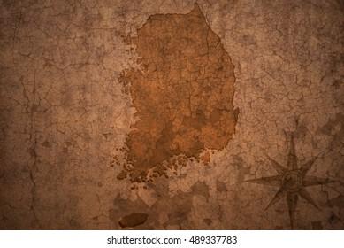 south korea map on a old vintage crack paper background