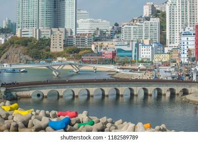 South Korea, November 10, 2017: People are seen walking on Busan's Songdo Skywalk, the longest skywalk on the water in South Korea.
