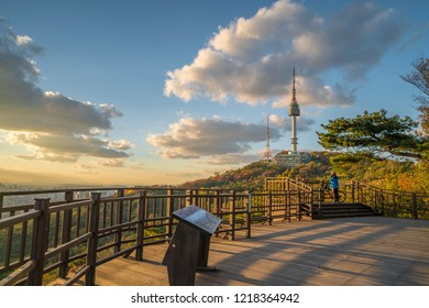 South Korea - November 27 2018 :Sunset Namsan Tower and autumn maple tree Namsan mountain in Seoul, South Korea.