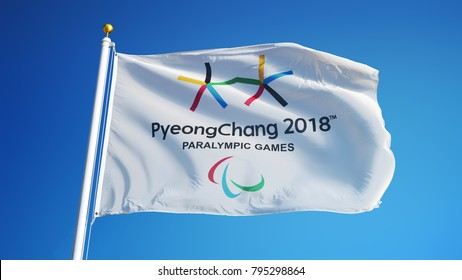 SOUTH KOREA PYEONGCHANG FEBRUARY 2018: Winter Paralympic Games flag waving in against blue sky, close up