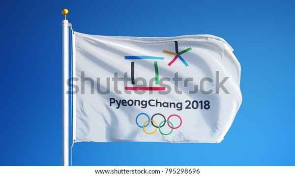 SOUTH KOREA PYEONGCHANG FEBRUARY 2018: Winter Olympic Games flag waving in against blue sky, close up