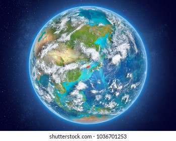 South Korea in red on model of planet Earth with clouds and atmosphere in space. 3D illustration. Elements of this image furnished by NASA.