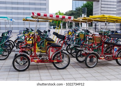 SOUTH KOREA, SEOUL - MAY 10, 2017: Italian Sirenetta surrey quadricycle ciclofan. Surrey is a four-wheeled open cycle carriage often with a canopy.