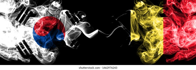 South Korea vs Belgium, Belgian smoky mystic flags placed side by side. Thick colored silky abstract smoke flags of South Korean and Belgium, Belgian
